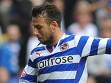Adam Le Fondre of Reading attacks during the Sky Bet Championship match between Reading v Watford at The Madejski Stadium on August 17, 2013