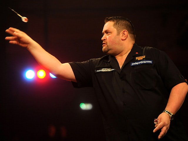 Alan Norris in action against Scott Waites during day one of the BDO Lakeside World Professional Darts Championships on January 4, 2013