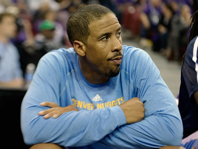 Andre Miller #24 of the Denver Nuggets takes a looks on from the bench against the Sacramento Kings late in the fourth quarter at Sleep Train Arena on October 30, 2013
