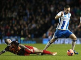 Brighton's Andrew Crofts and Reading's Danny Guthrie in action during their FA Cup third round match on January 4, 2013