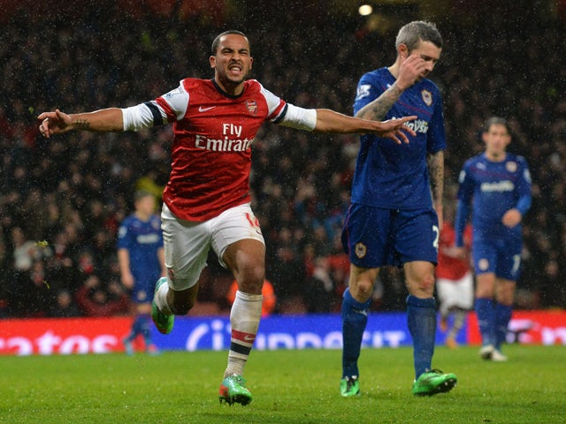Arsenal's English midfielder Theo Walcott celebrates scoring their second goal during the English Premier League football match between Arsenal and Cardiff City at the Emirates Stadium in London on January 1, 2014