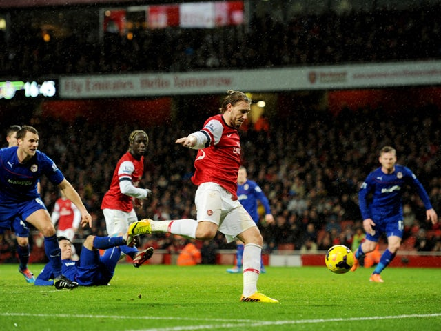 Nicklas Bendtner of Arsenal scores their first goal during the Barclays Premier League match between Arsenal and Cardiff City at Emirates Stadium on January 1, 2014