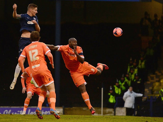Southend's Barry Corr heads in the opening goal against Millwall during their FA Cup third round match on January 4, 2013