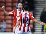 Stoke's Charlie Adam celebrates with teammate Marc Wilson after scoring his team's second goal against Leicester during their FA Cup third round match on January 4, 2013