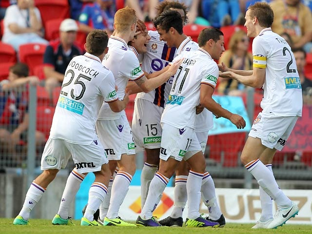 Perth Glory's Chris Harold is congratulated by teammates after scoring the opening goal against Newcastle Jets during their A-League match on January 4, 2013