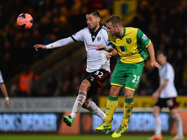 Fulham's Clint Dempsey and Norwich's David Fox battle for the ball during their FA Cup third round match on January 4, 2013