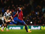 Jason Puncheon of Crystal Palace scores from the penalty box during the Barclays Premier League match between Crystal Palace and Norwich City at Selhurst Park on January 1, 2014