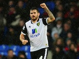 Bradley Johnson of Norwich City celebrates scoring during the Barclays Premier League match between Crystal Palace and Norwich City at Selhurst Park on January 1, 2014