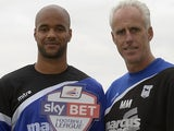 David McGoldrick of Ipswich Town holds his Player of the Month award for September next to manager Mick McCarthy