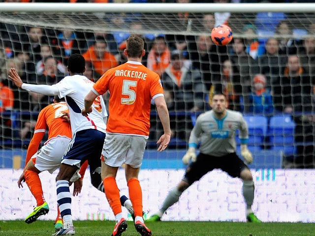 Bolton's David Ngog scores the opening goal against Blackpool during their FA Cup third round match on January 4, 2013