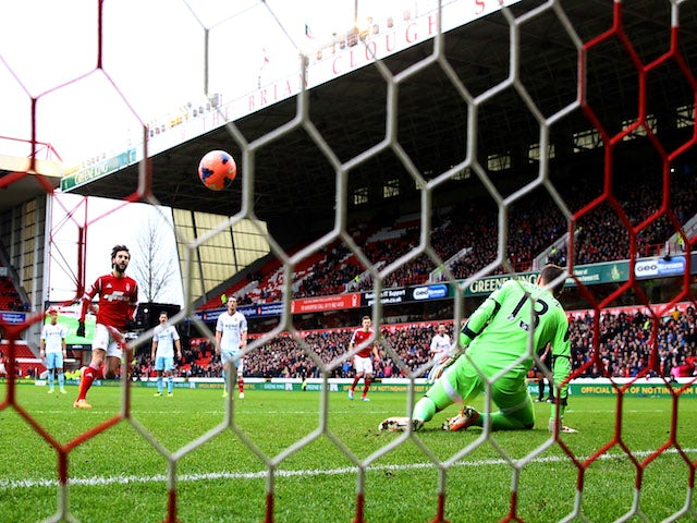 Djamel Abdoun of Nottingham Forest chips a penalty kick past goalkeeper Adrian of West Ham United to score their first goal during the FA Cup Third Round tie on January 5, 2014