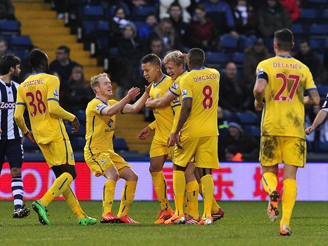 Crystal Palace's Dwight Gayle is congratulated by teammates after scoring the opening goal against West Brom during their FA Cup third round match on January 4, 2013