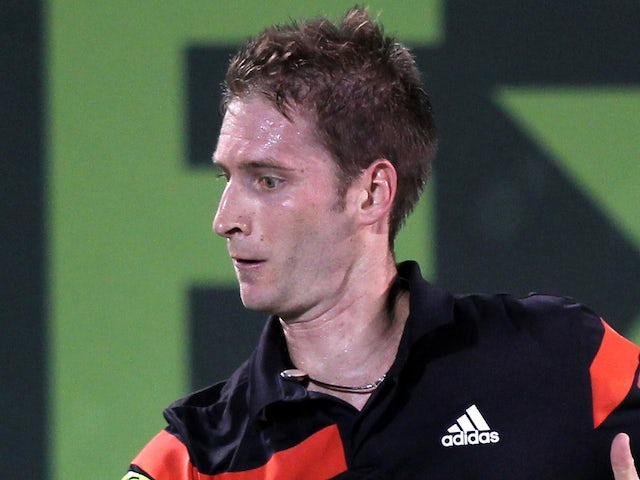 Germany's Florian Mayer returns the ball to Romania's Victor Hanescu during their quarter-finals tennis match in Qatar's ExxonMobil Open in Doha on January 2, 2014