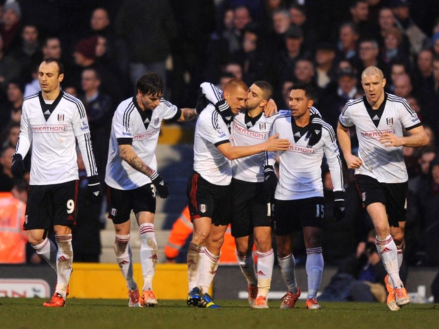 Steve Sidwell of Fulham is kissed by teammate Adel Taarabt after scoring a goal to level the scores at 1-1 during the Barclays Premier League match between Fulham and West Ham United at Craven Cottage on January 1, 2014
