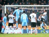 Gavin Tomlin of Port Vale scores the opening goal during the Budweiser FA Cup third round match between Port Vale and Plymouth Argyle at Vale Park on January 5, 2014