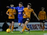 Cody McDonald of Gillingham battles with Sam Ricketts of Wolves during the Sky Bet League One match between Gillingham and Wolverhampton Wanderers at Priestfield Stadium on January 3, 2014