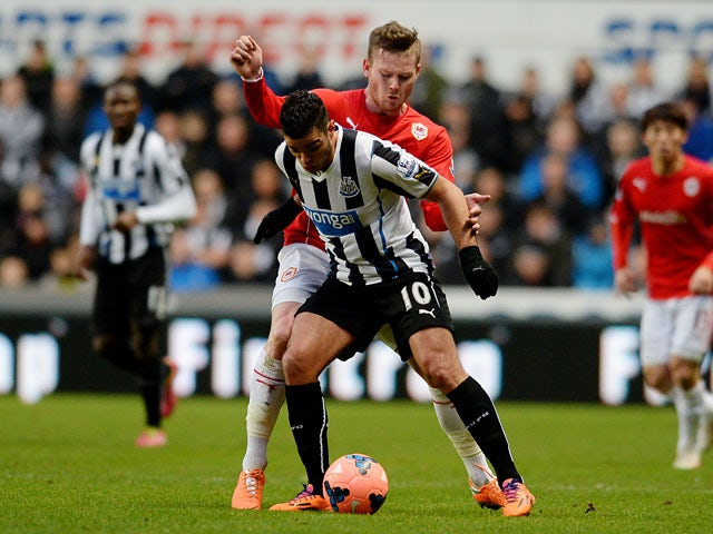 Newcastle's Hatem Ben Arfa and Cardiff's Aron Gunnarsson in action during their FA Cup third round match on January 4, 2013