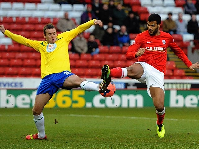Barnsley's Jacob Mellis and Coventry's Peter Ramage battle for the ball during their FA Cup third round match on January 4, 2013