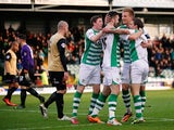 Yeovil's James Hayter celebrates with teammates after scoring the opening goal against Leyton Orient during their FA Cup third round match on January 4, 2013