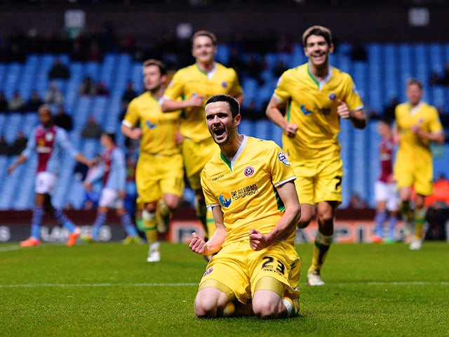 Sheffield United's Jamie Murphy celebrates after scoring the opening goal against Aston Villa during their FA Cup third round match on January 4, 2013