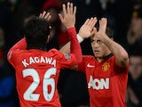 Manchester United's Mexican striker Javier Hernandez celebrates with Manchester United's Japanese midfielder Shinji Kagawa (L) after scoring an equalising goal during the English FA Cup third round tie on January 5, 2014