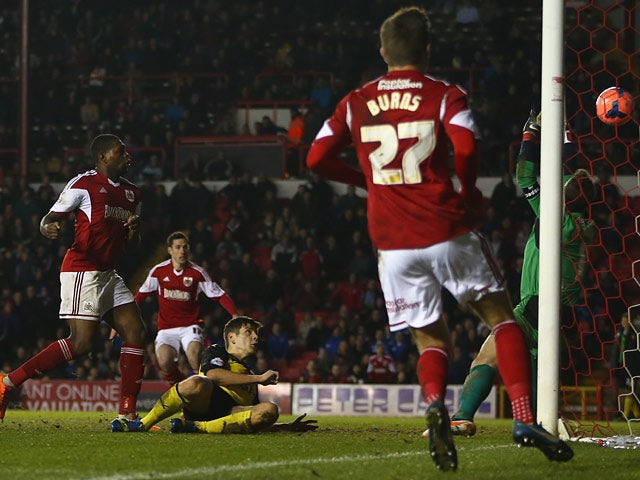 Bristol City's Jay Emmanuel-Thomas scores the equalising goal against Watford during their FA Cup third round match on January 4, 2013
