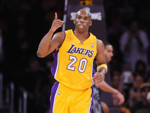 Los Angeles Laker's Jodie Meeks reacts after sinking a basket against the Minnesota Timberwolves at Staples Center on December 20, 2013