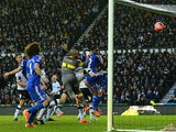 John Obi Mikel of Chelsea heads the ball to score their first goal during the Budweiser FA Cup Third Round match against Derby County on January 5, 2014