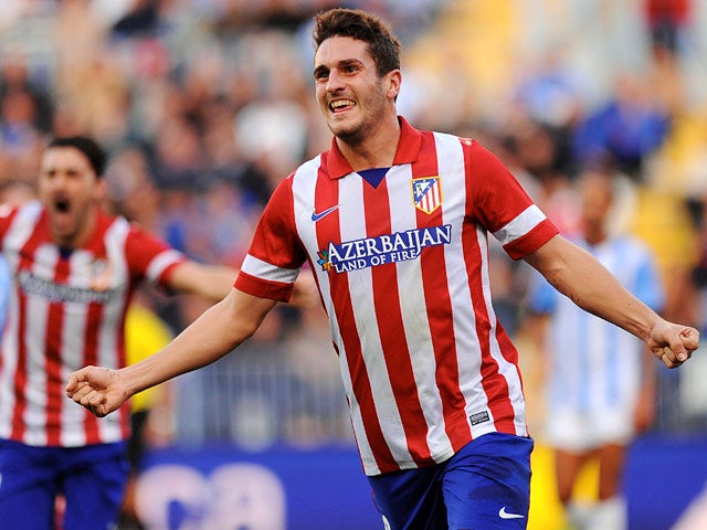 Atletico Madrid's Koke celebrates after scoring the opening goal against Malaga during their La Liga match on January 4, 2013
