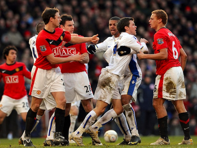 Leeds United's English midfielder Jonny Howson (2nd R, front) confronts Manchester United's English defender Wes Brown (R) during their English FA Cup football match on January 3, 2010