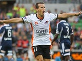 Brisbane Roar's Liam Miller celebrates after scoring the opening goal against Melbourne Victory during their A-League match on January 4, 2013