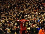 Liverpool's Uruguayan striker Luis Suarez celebrates scoring their second goal during the English Premier League football match between Liverpool and Hull City at Anfield in Liverpool, northwest England, on January 1, 2014