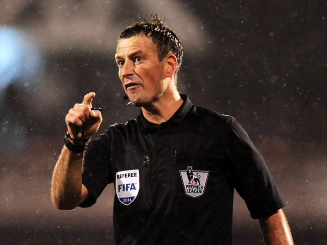 Referee Mark Clattenburg in action during the Barclays Premier League match between Fulham and West Ham United at Craven Cottage on January 1, 2014