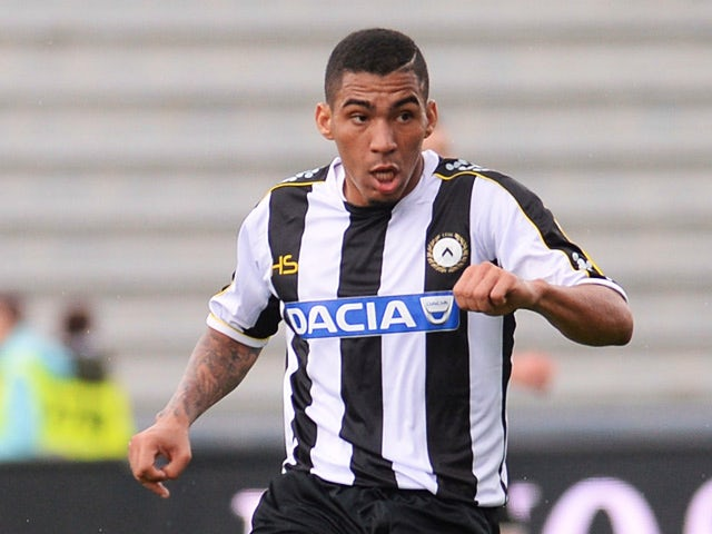 Udinese's Mathias Ranegie in action against Cagliari during their Serie A match on October 6, 2013