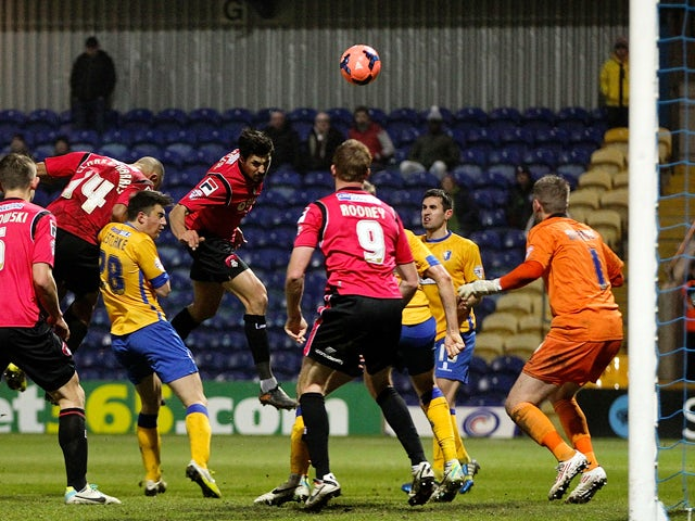 Matteo Lanzoni of Oldham heads home his team's third goal of the game during the FA Cup Second Round Replay match between Mansfield Town and Oldham Athletic at One Call Stadium on December 17, 2013