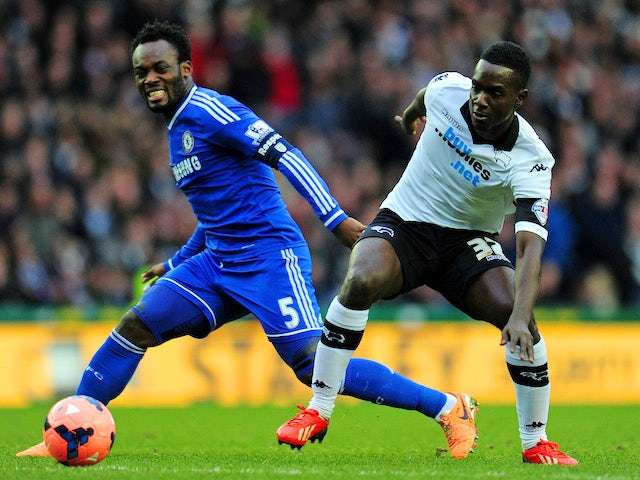 Michael Essien of Chelsea and Simon Dawkins of Derby battle for the ball during the Budweiser FA Cup Third Round match on January 5, 2014