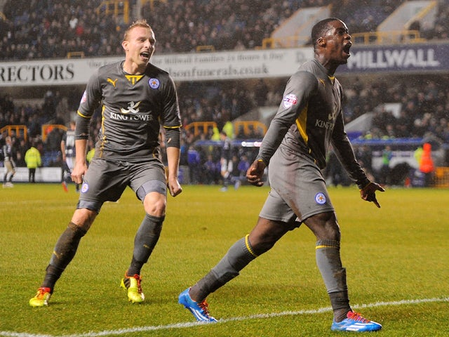 Jeff Schlupp of Leicester City celebrates his goal with Ritchie De Laet during the Sky Bet Championship match between Millwall and Leicester City at The Den on January 01, 2014