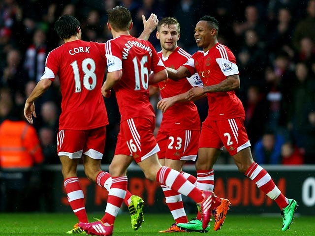 Southampton's Nathaniel Clyne celebrates with teammates after scoring the opening goal against Burnley during their FA Cup third round match on January 4, 2013