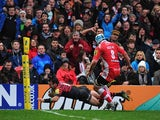 Saracens' Neil de Kock dives over to score the first try against Gloucester during their Aviva Premiership match on January 4, 2013