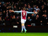 Aston Villa's Nicklas Helenius celebrates after scoring his team's first goal against Sheffield United during their FA Cup third round match on January 4, 2013