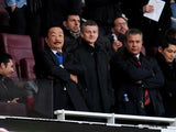 Molde manager Ole Gunnar Solskjaer and Cardiff City owner Vincent Tan look on from the stands prior to the Barclays Premier League match between Arsenal and Cardiff City at Emirates Stadium on January 1, 2014