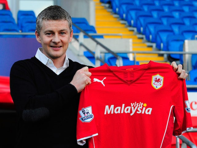 Ole Gunnar Solskjaer holds aloft the club shirt after being unveiled as the new Cardiff City Manager at Cardiff City Stadium on January 2, 2014