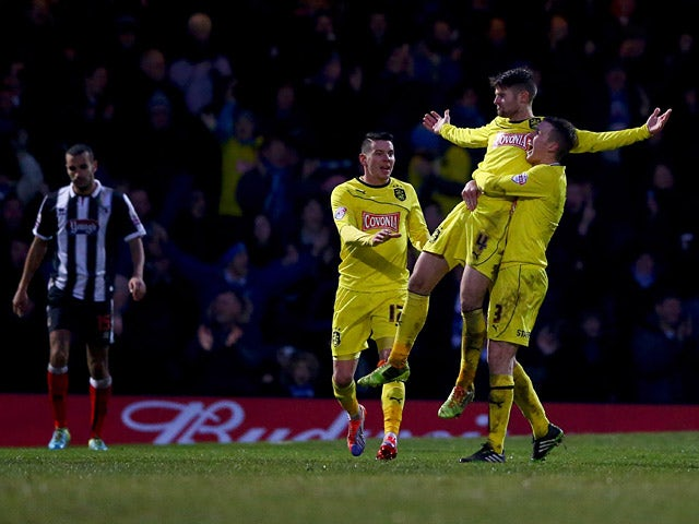 Huddersfield's Oliver Norwood celebrates with teammates after scoring his team's first goal against Grimsby during their FA Cup third round match on January 4, 2013