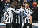 Newcastle's Papiss Cisse is congratulated by teammates after scoring the opening goal against Cardiff during their FA Cup third round match on January 4, 2013