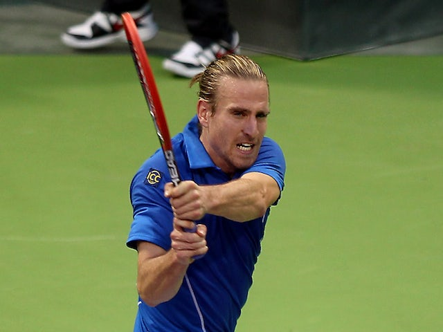 Germany's Peter Gojowczyk returns the ball to his countryman Dustin Brown during their tennis match in Qatar's ExxonMobil Open in Doha on January 2, 2014
