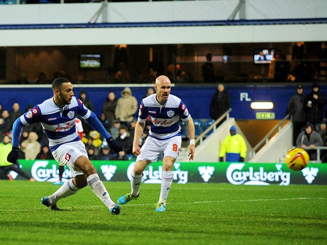 Matt Phillips of Queens Park Rangers scores 1st goal as he's challenged by Ross Turnbull of Doncaster Rovers during the Sky Bet Championship match between Queens Park Rangers and Doncaster Rovers at Loftus Road on January 1, 2014