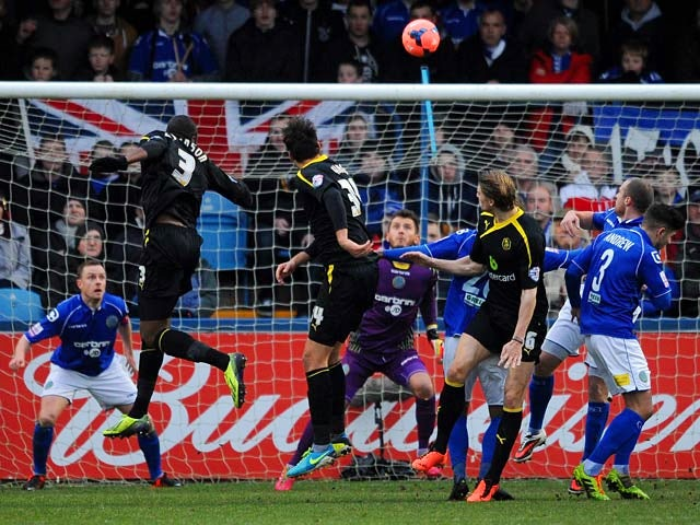 Sheffield Wednesday's Reda Johnson scores the opening goal against Macclesfield during their FA Cup third round match on January 4, 2013