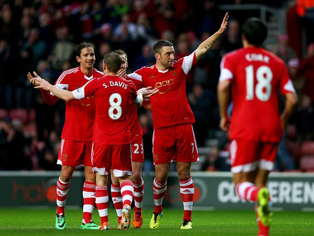 Southampton's Rickie Lambert celebrates with teammates after scoring his team's second goal against Burnley during their FA Cup third round match on January 4, 2013