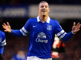 Everton's Ross Barkley celebrates after scoring the opening goal against QPR during their FA Cup third round match on January 4, 2013