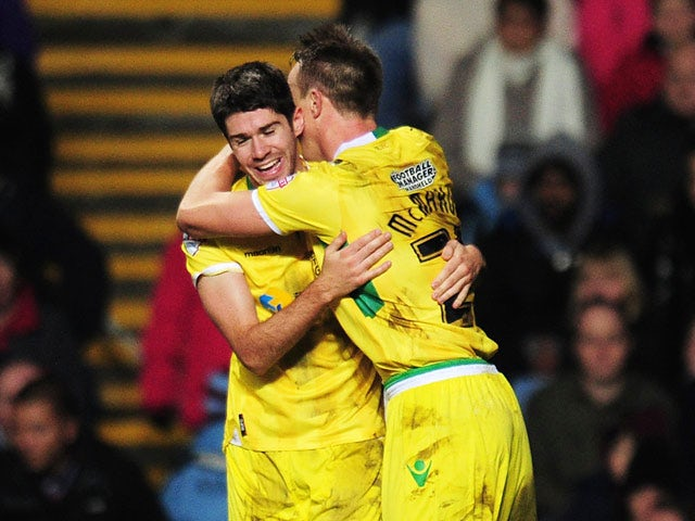 Sheffield United's Ryan Flynn celebrates with teammate Tony McMahon after scoring his team's second goal during their FA Cup third round match on January 4, 2013